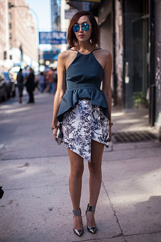 Metallic shoes, sunglasses and a tiny clutch polish off this New York Fashion Week showgoer's feminine outfit.