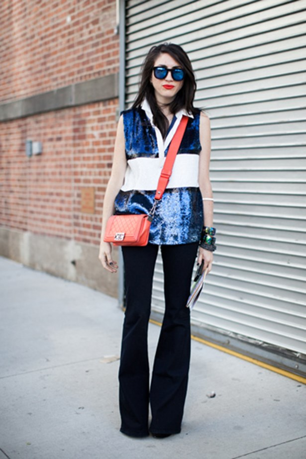 These intense blue shades pack a punch when paired with a scarlet pout. This New York Fashion Week attendee continues the red-and-blue theme with a Chanel satchel and sequin top.