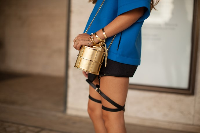 Gold accessories and thigh suspenders