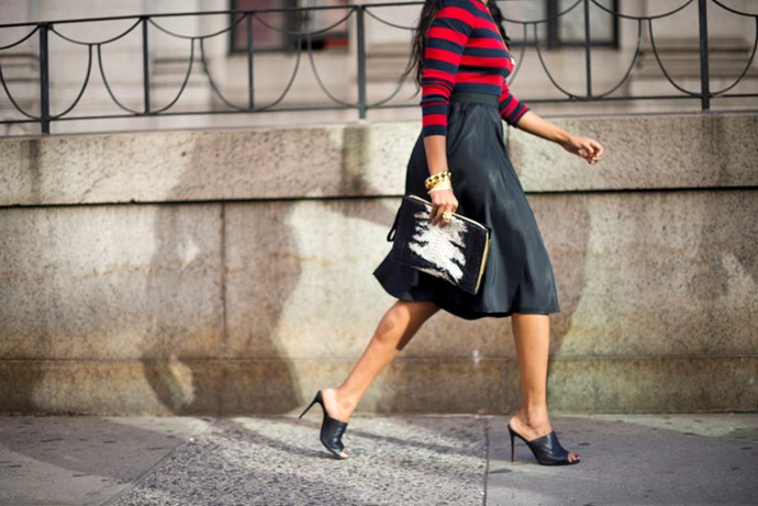 High-waisted skirt paired with classic mules