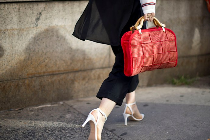 White heels and woven handbag