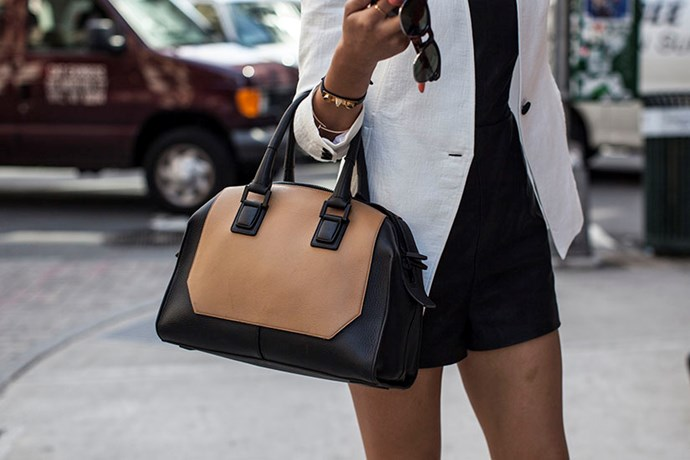 Black and tan handbag