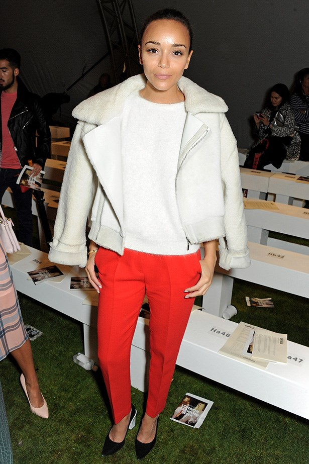 Ashley Madekwe: Taking some time off shooting the next season of <em>Revenge</em>, Ashley attended the Topshop Unique show in red cigarette-leg pants and an animal-textured white jacket.