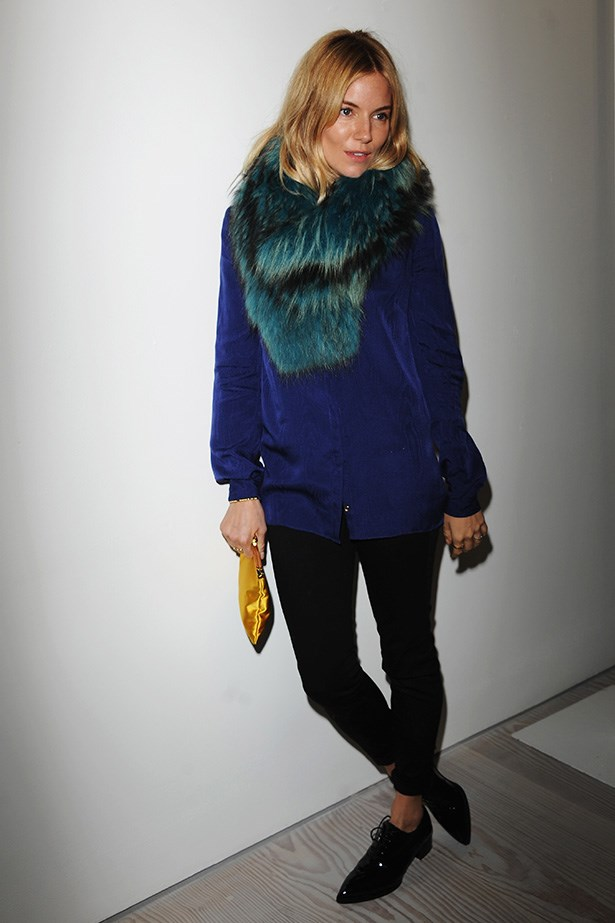 Sienna Miller: Before taking her seat to support good friend Matthew Williamson, the actress posed for the paps.