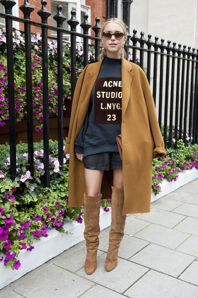 Over-the-knee boots are the perfect trans-seasonal piece. Layer up with a slogan sweater and jacket and top with statement shades.