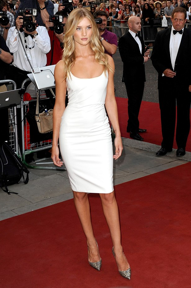 Rosie perfects modern sex appeal with a fresh face and a white PVC Versace AW13 form-fitting dress at the GQ Men Of The Year awards in London.