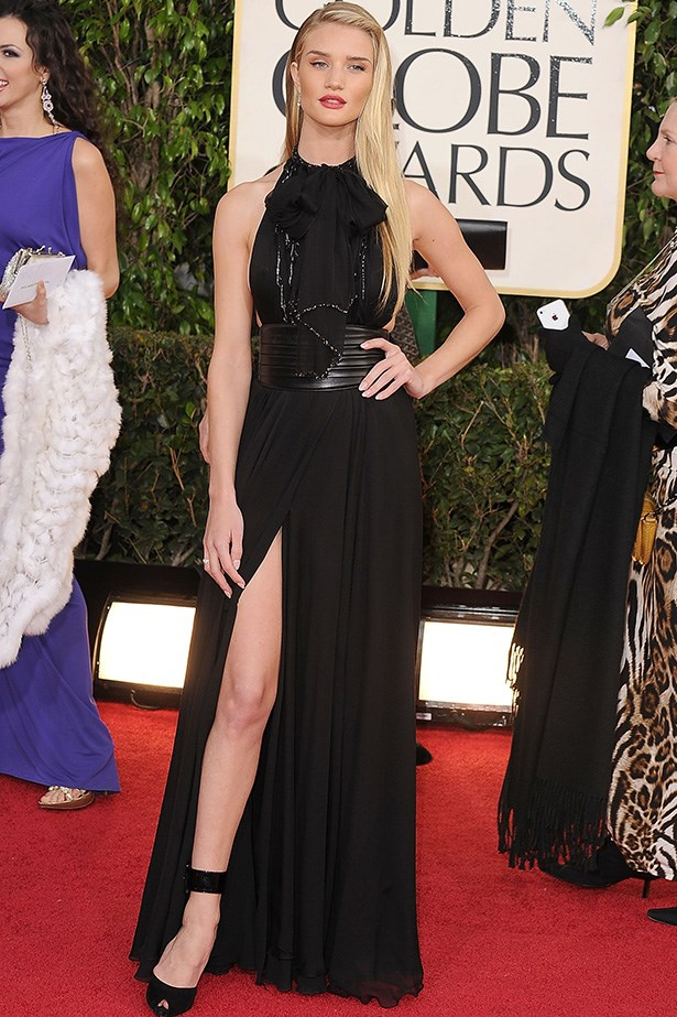 In a delicate balancing act, Rosie chose a black high-neck Saint Laurent Paris gown with a thigh-high split showing off her long limbs at the 70th Annual Golden Globe Awards in Los Angeles.