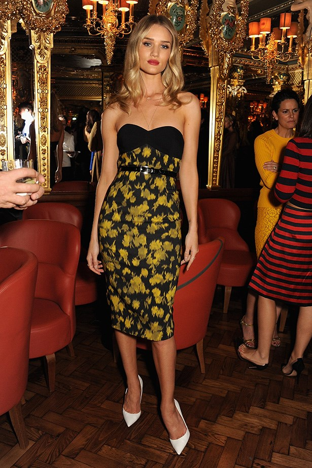 Taking a cue from Mad Men, Rosie is every part the vintage screen-siren in a Michael Kors strapless leaf-print dress at the Vogue dinner in honour of Michael Kors in London hosted by editor Alexandra Shulman.