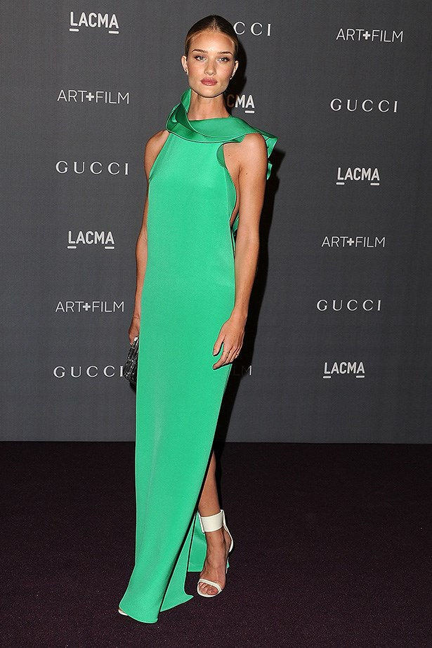 Rosie has onlookers green with envy in this floor-length ruffled gown from Gucci's SS13 collection, complete with her signature thigh-high split at the LACMA Art and Film Gala in Los Angeles.