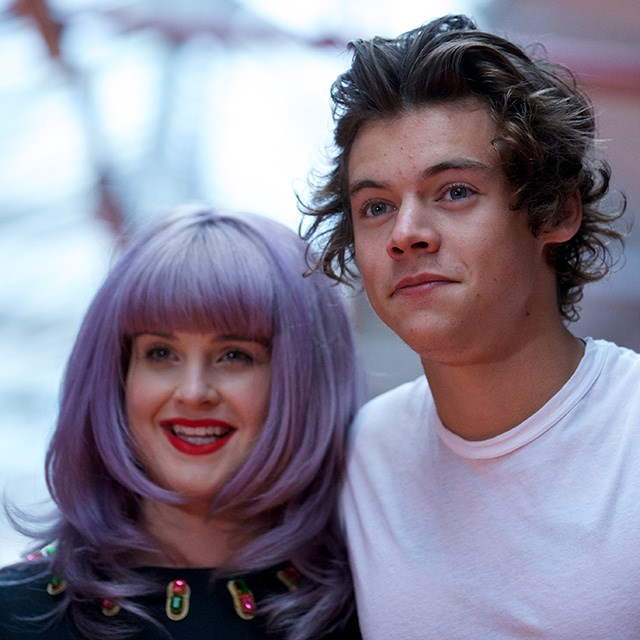 Styles looks just as perplexed by Kelly Osbourne's mauve do' as we are. Here they are posing for a snap at the House of Holland show during London Fashion Week.