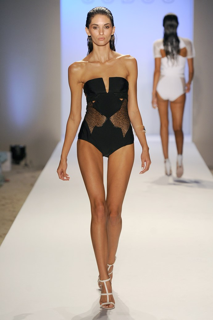 A classic black one piece is re-imagined with mesh detail.
