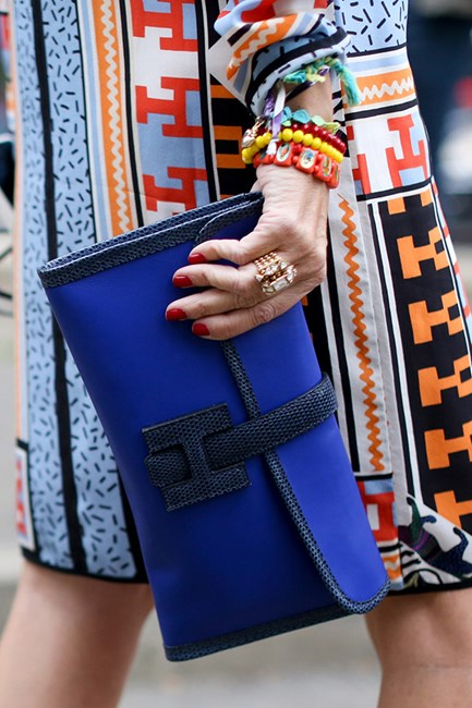 More is more! Clash busy prints with a cocktail ring and a classic Hermès clutch to ensure all eyes are on you.