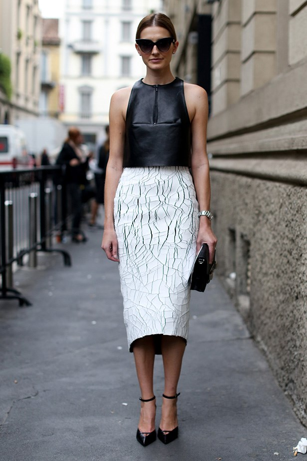Australian fashion editor Kate Waterhouse looks picture perfect in this Dion Lee vest and Balenciaga skirt. For a high-street alternative, tuck a black vest into a statement skirt and finish off with glossy black accessories.