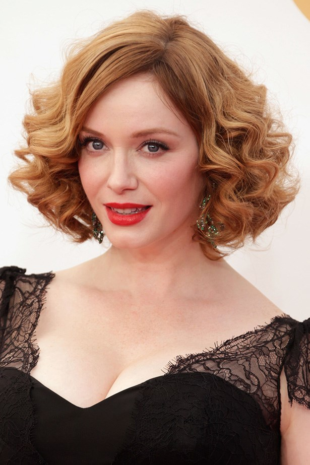 Mad Men's Christina Hendricks pairs her signature red hair with a bright red lip.