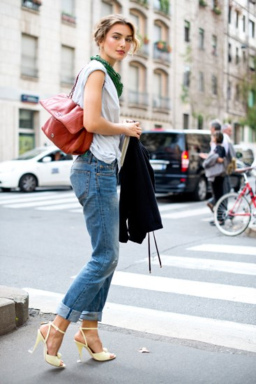 Dress up jeans with elegant heels and a quilted purse.