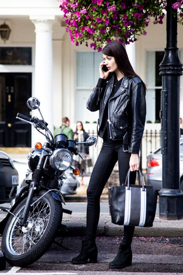 An all-black outfit never fails to look chic (a motorcycle helps, too).