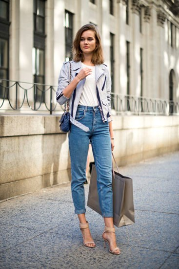 Elongate your legs in high-waisted jeans by wearing nude heels.