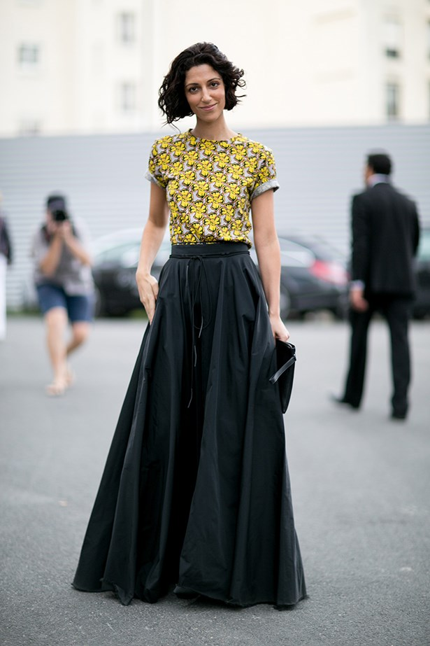 A refined floor-length skirt styled with a floral t-shirt on the streets of Paris.