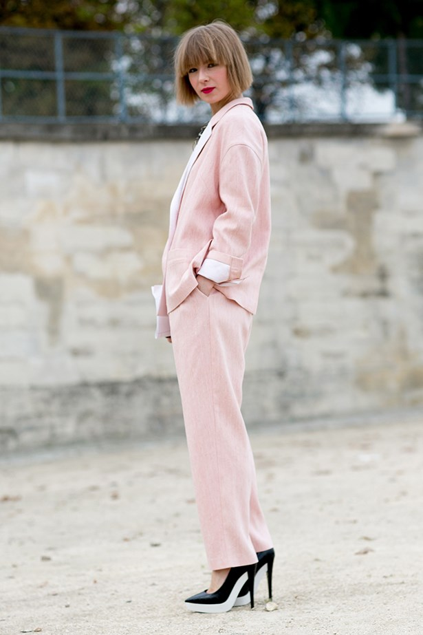 Vika Gazinskaya stepped out at the shows in a pastel pink pant suit teamed with a red lip and heels with serious platform.