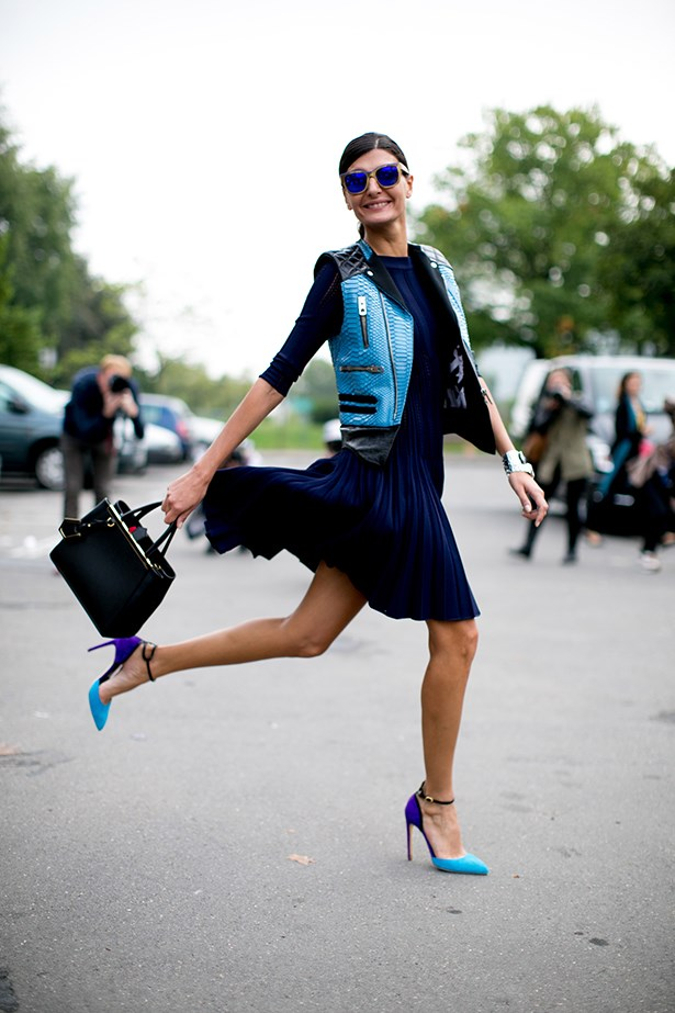 Fashion editor Giovanna Battaglia wears accents of aqua.