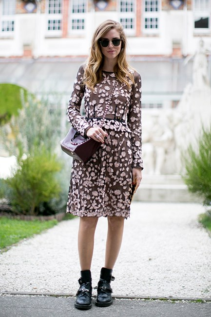 Chiara Ferragni toughens up a delicate floral dress with biker books and a studded Valentino tote. Rock on!
