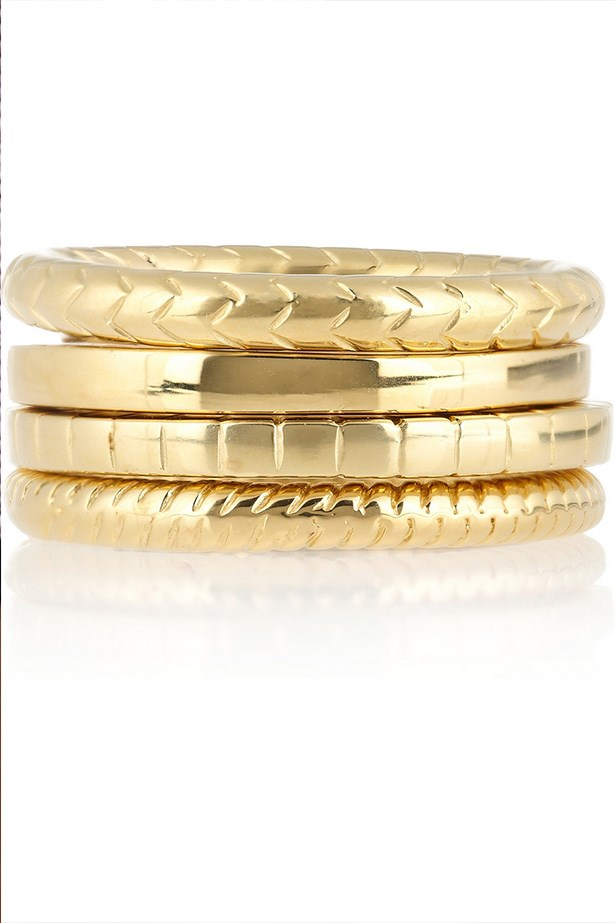 Gold-plated rings, $1,571 for set of four, Saint Laurent, net-a-porter.com