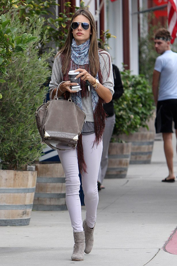 A casual nod to Western styling in a tonal fringed scarf and cowboy-boot combo.