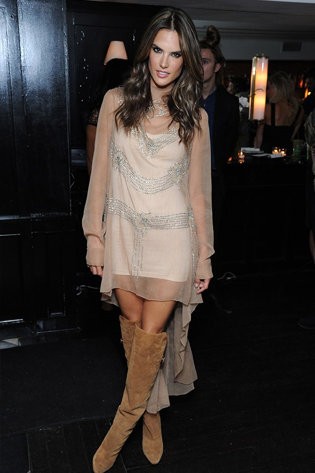 The legs that have walked a thousand runways are shown off to perfection in this mini-dress, but given a touch of modesty with suede over-the-knee boots.