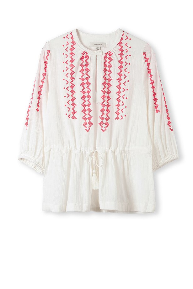 <strong>Want to steal her style? Here's our edit of Alessandra-inspired pieces.</strong><br><br> Embroidered top, $99.95, Country Road, countryroad.com.au