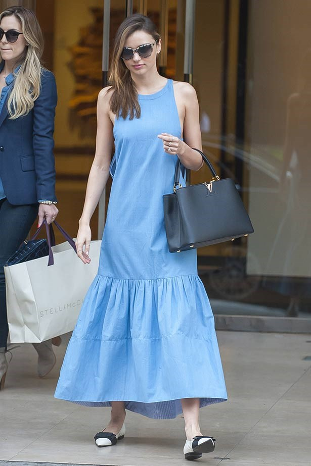 Feeling blue? The Aussie beauty stepped out in a drop waist dress and bag from the Louis Vuitton Resort 14 collection, teamed with Stella McCartney frames and her favourite bow-embellished Miu Miu flats.