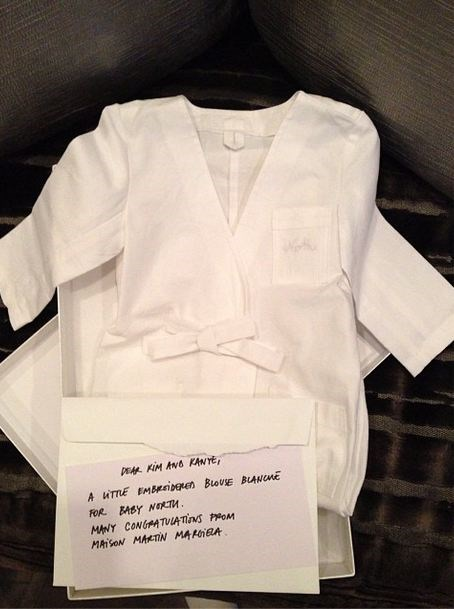 """Dear Kim and Kanye. A little embroidered blouse blanche for baby North. Many congratulations from Maison Martin Margiela"" - French fashion house Maison Martin Margiela gifted the baby one of its coveted lab coats. Jealous, us?"