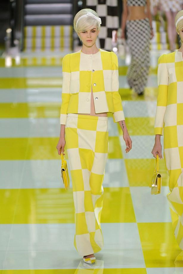 Australian model Ruby Jean Wilson wears a lemon checkerboard print design at the Louis Vuitton SS13 show.