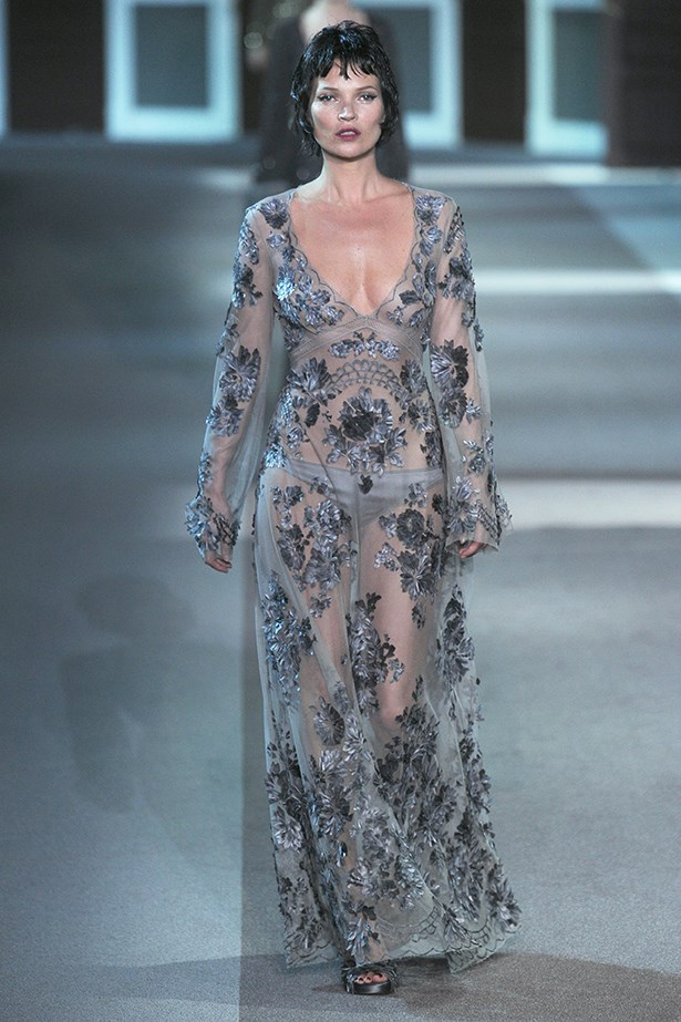 Kate Moss wears a delicate embroidered gown at Louis Vuitton AW13.