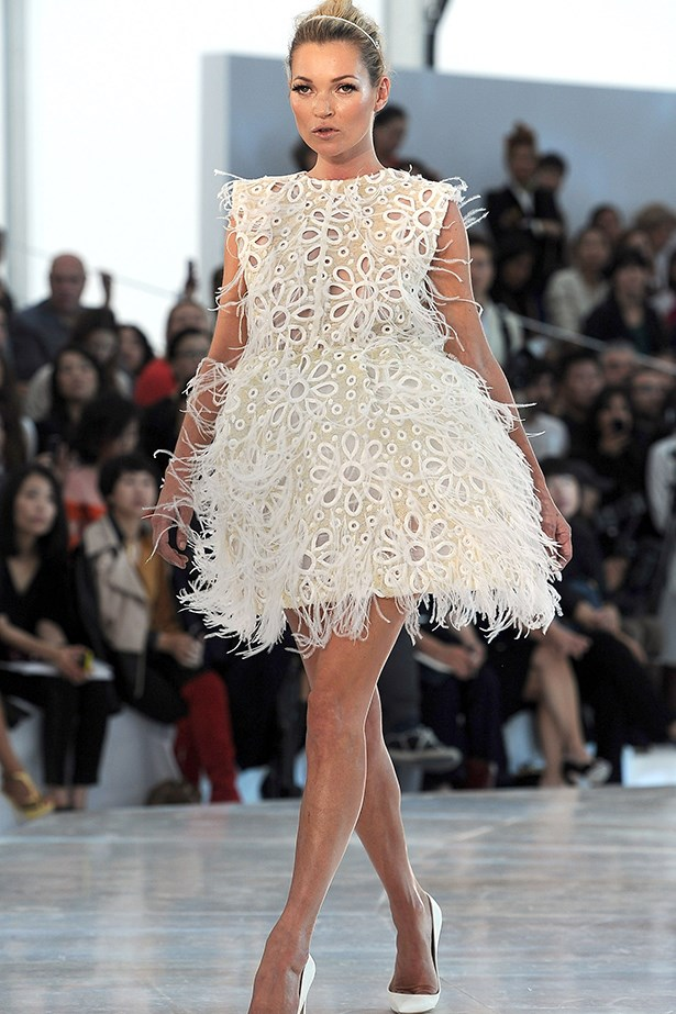Louis Vuitton runway regular Kate Moss lit up the runway at the SS12 show in a feminine floral feather dress and headband.
