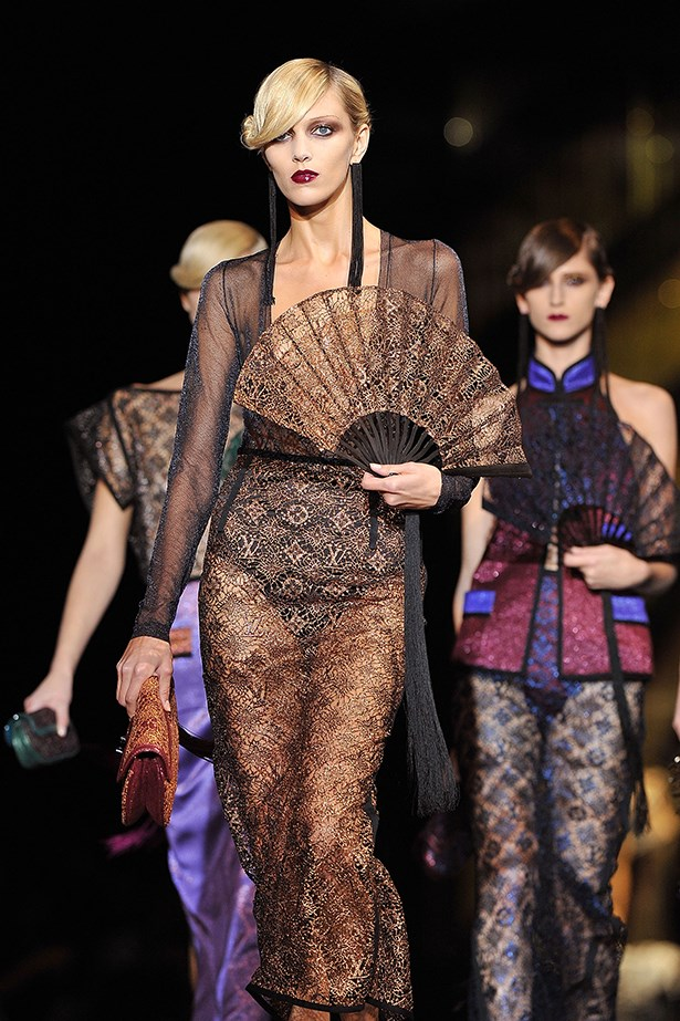 Louis Vuitton SS11 show featured detailed molten lace, sheer tops and oriental fans.