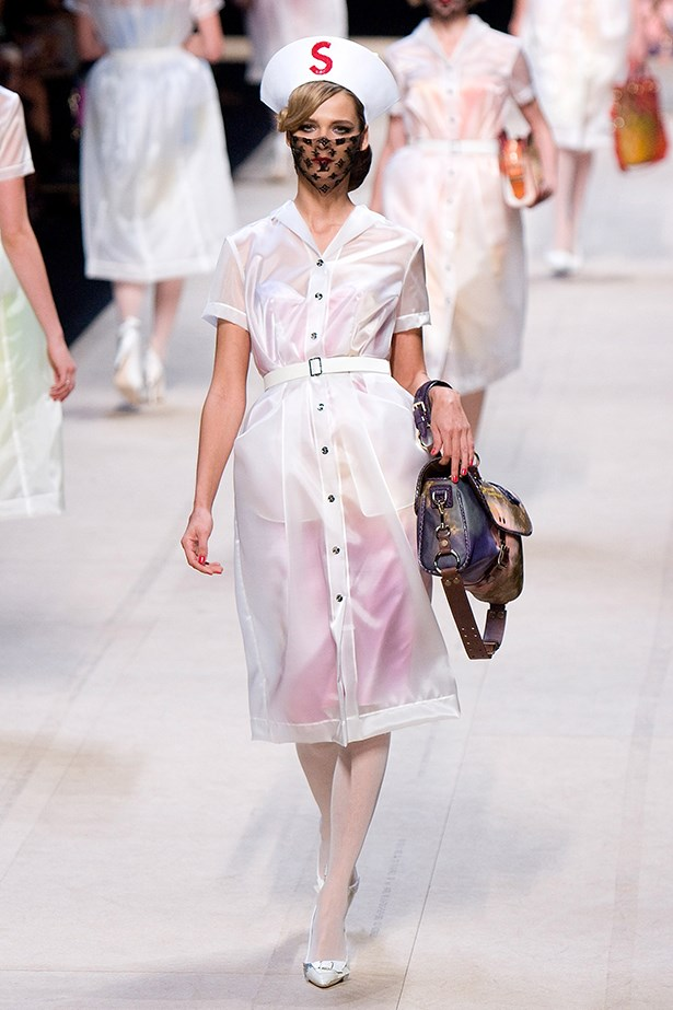 Models donned sheer white coats and nurse-inspired headpieces at the Louis Vuitton SS08 show.