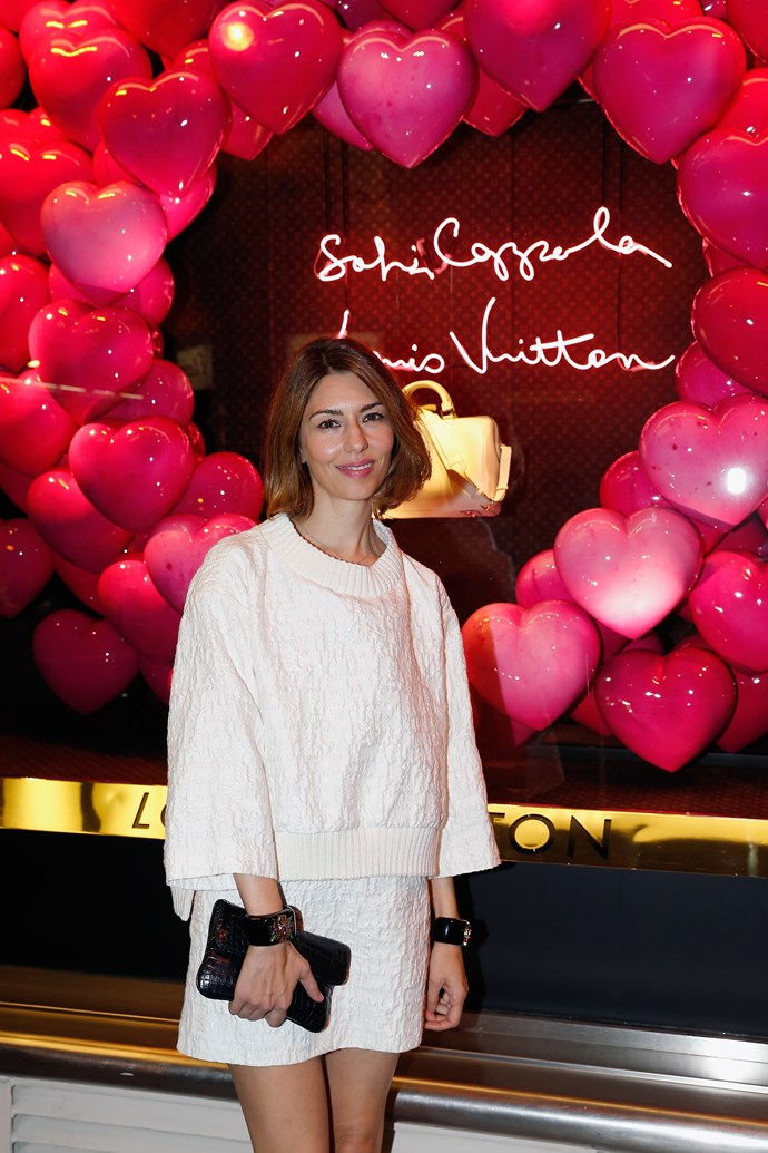 Sofia Coppola in front of the window display she crafted for Paris' Le Bon Marché Rive Gauche