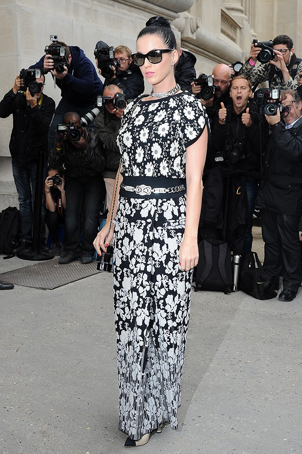 Katy Perry opted to go half-half with the trend at Chanel's spring/summer 14 show. The singer wore a monochrome knit dress from the French fashion house, featuring a floral top and leaf-print skirt.