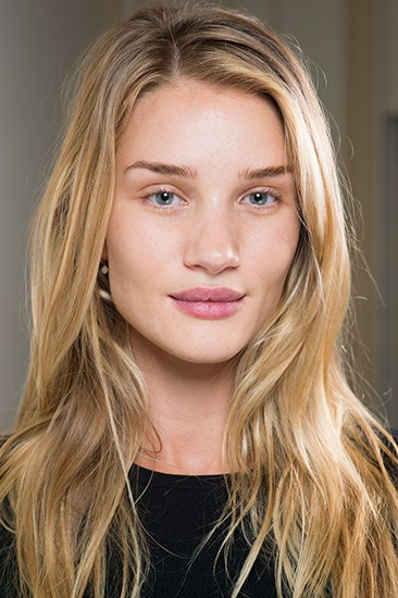 """<b><u>Balmain</u><br> No makeup makeup:</b> Face oil, concealer, eyelash curler and ChapStick.<br> <b>The look: </b>""""Minimal of minimal of minimal,"""" said makeup artist Tom Pecheux to WWD describing Balmain's beauty look. The aim of the game was to cover blemishes and really go naked.<br> <b>How-to:</b> Step away from your usual makeup kit. Massage facial oil into the skin to get that dewy glow, then simply dot concealer onto any blemishes. If you're up to cheat a little, curl the lashes (don't be tempted by mascara!) and give the lips a swipe of ChapStick."""
