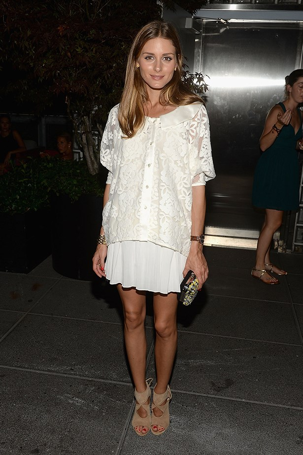 Olivia Palermo takes a feminine approach to the trend and pairs a sheer top with a ruffled skirt, polished off with suede Aquazzura heels.