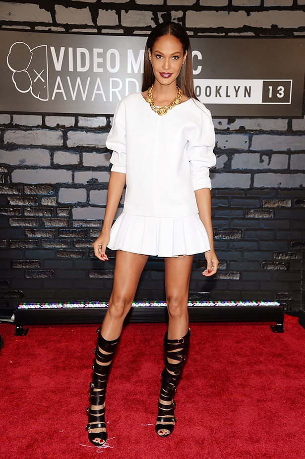 Joan Smalls proves wearing white allows you to make big statements with your accessories.