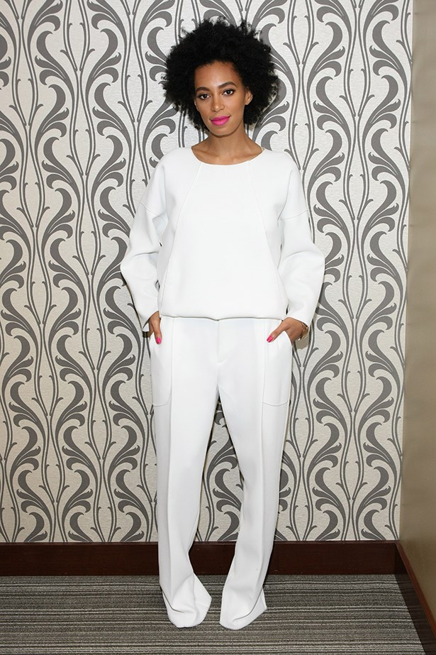 Solange Knowles is known for taking risks and <em>always</em> pulling them off. Her matching nail polish and lipstick truly complete the look.