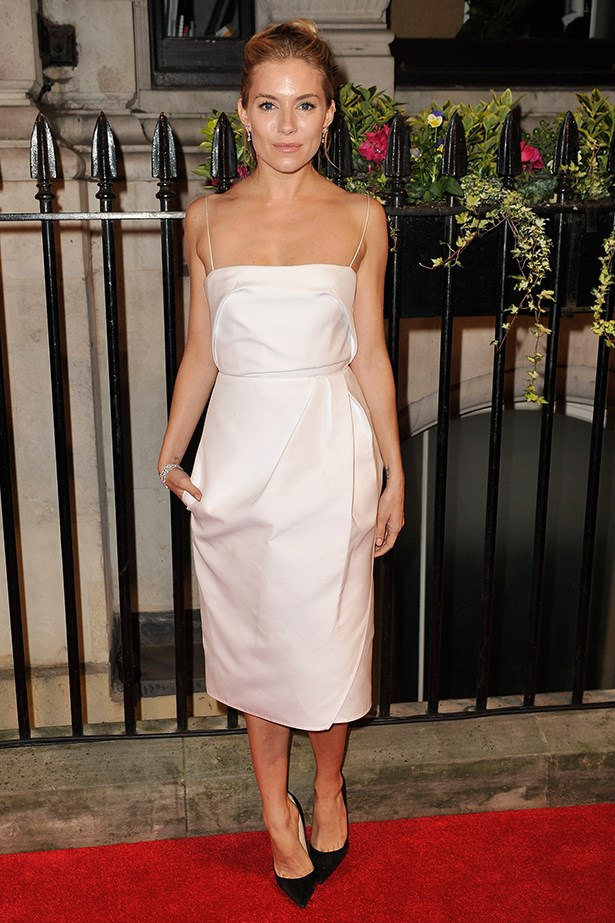 Sienna Miller looks flawless in this ivory Carven dress.