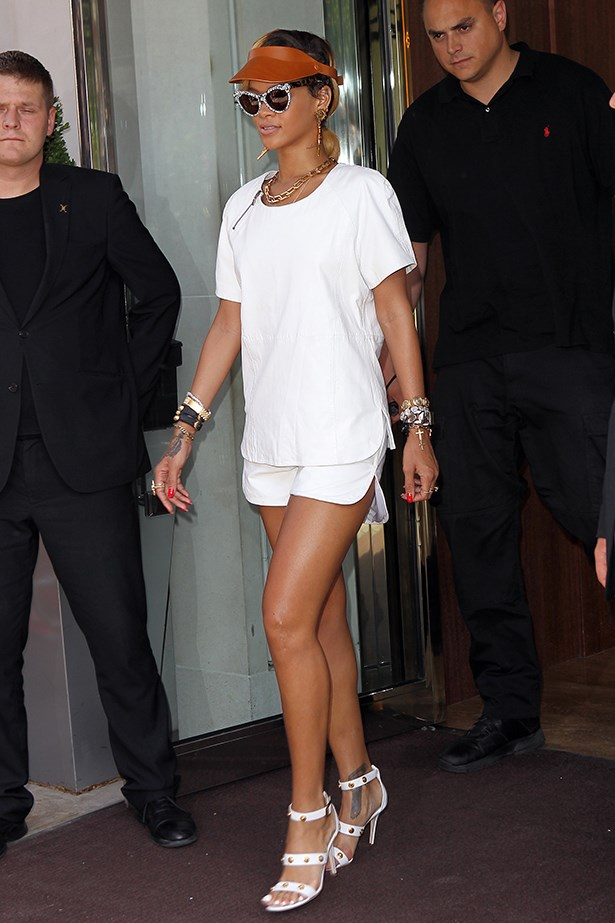 Rihanna uses her white-on-white outfit as a blank canvas, piling on the accessories to make a statement.