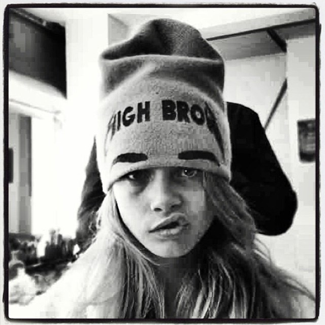 Looking rough and tough in a beanie and scowl. Image: instagram @caradelevingne