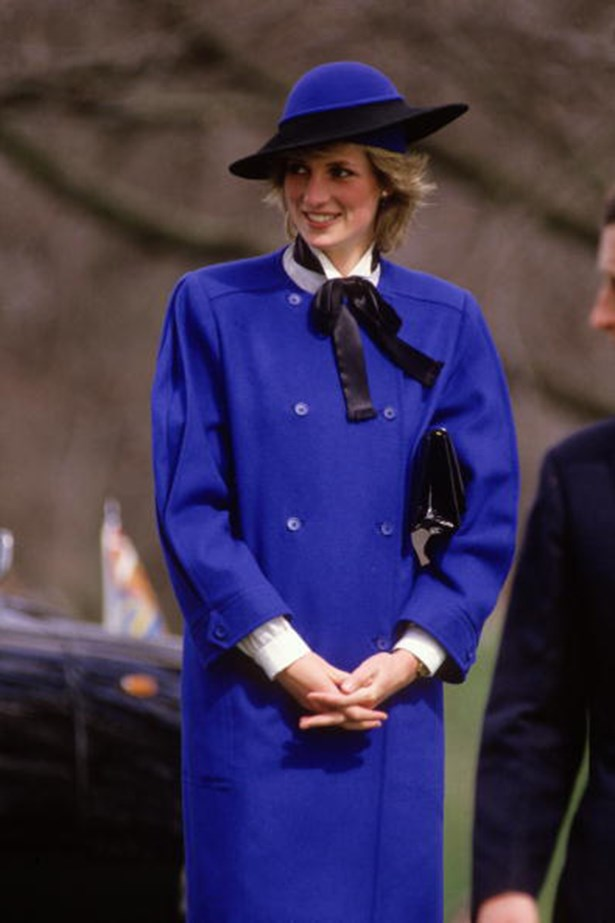 They don't call it royal blue for nothing. The Princess steps out in a Bellville Sassoon ensemble, complete with a pussy bow and matching hat by Australian milliner Frederick Fox.