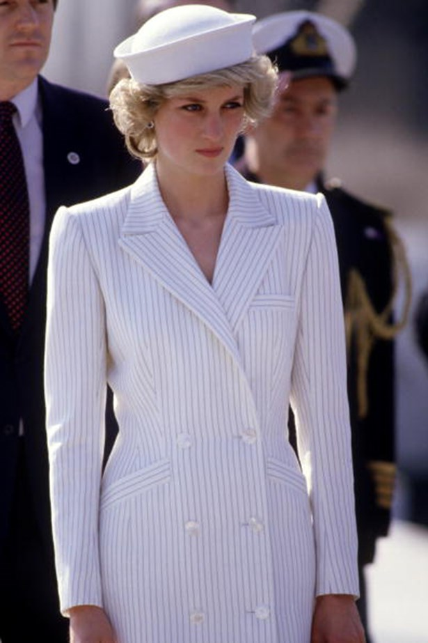 Visiting a naval base in La Spenzia on her Royal Tour of Italy in 1985, the People's Princess suited up for the occasion in a tailored white blazer with navy pinstripes, thanks again Catherine Walker, and a themed hat.