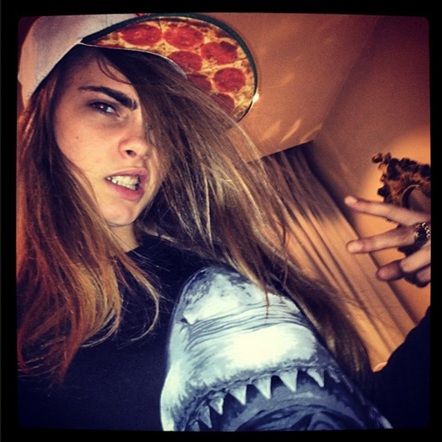 Cara is tom-boy tough in a snap back and snarl. Image: instagram @caradelevingne