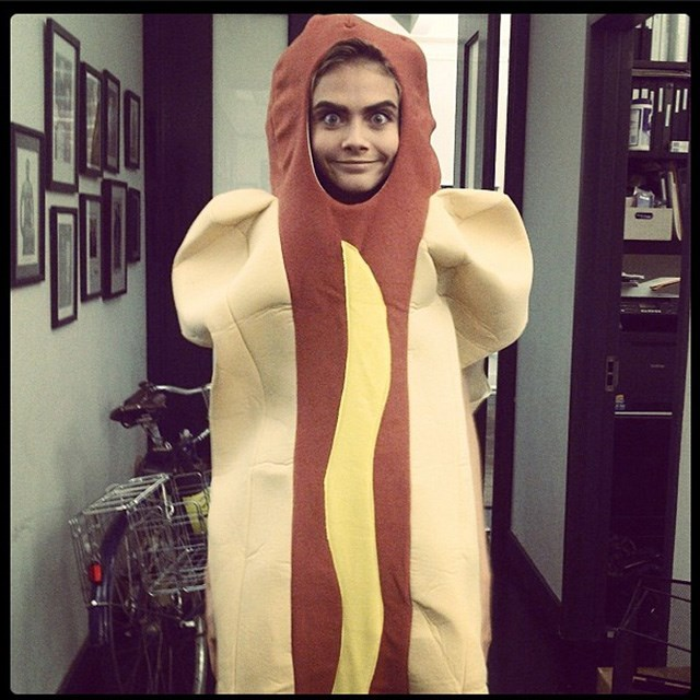 Only Cara could make a hot-dog onesie look like chic. Image: instagram @caradelevingne