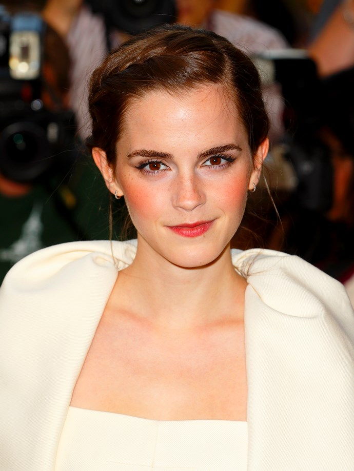 We've watched Emma Watson – and her freckled face – grow up over the years. And now she's, well, all grown up.